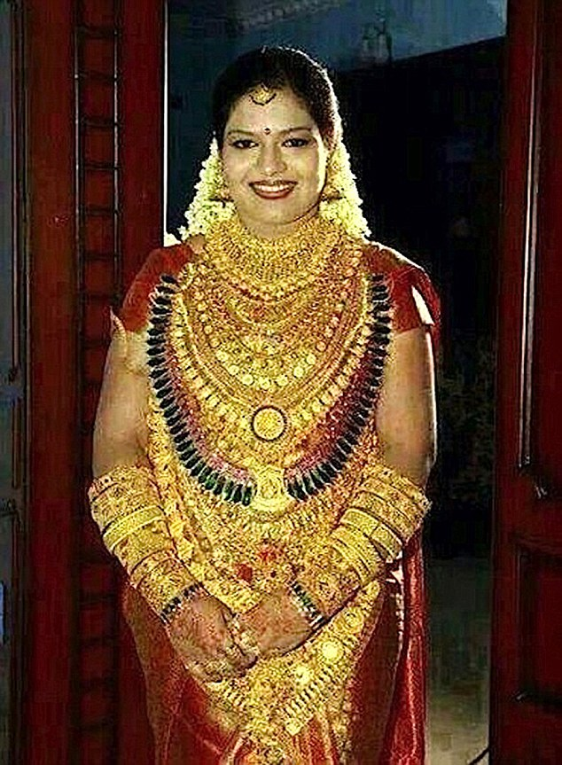 "Pic shows: Bride was covered in gold for the wedding in India. An Indian sweet maker made sure his daughter was the golden girl at her upcoming wedding by covering her in gold jewellery worth more than 400,000 GBP. The man who was not named nevertheless came under fire after it was revealed he needed a police guard to protect him and his daughter as they turned up covered in gold for the wedding in India's southern Andhra Pradesh state. Police spokesman Sandeep Kumar in Tirupati, a holy city known for its famous temple of Lord Vishnu, confirmed that the man and his daughter, who he declined to name, had worn gold jewellery throughout the ceremony. He said: ""It is not a crime to wear such a large amount of gold, but there could have been a crime once people heard about it. We just wanted to make sure there were no problems in advance."" The move was widely condemned on social media sites once the images from a mobile phone was shared, with people branding it both humiliating and shocking. Indians, one of the world's largest consumers of gold, spend huge amounts in buying gold jewellery for family weddings, and recently several wealthy Indians have been seen sporting shirts made out of solid gold thread. This father of the bride reportedly made his millions from selling confectionery in India. (ends)"